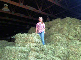 Stacking square hay bales in our barn